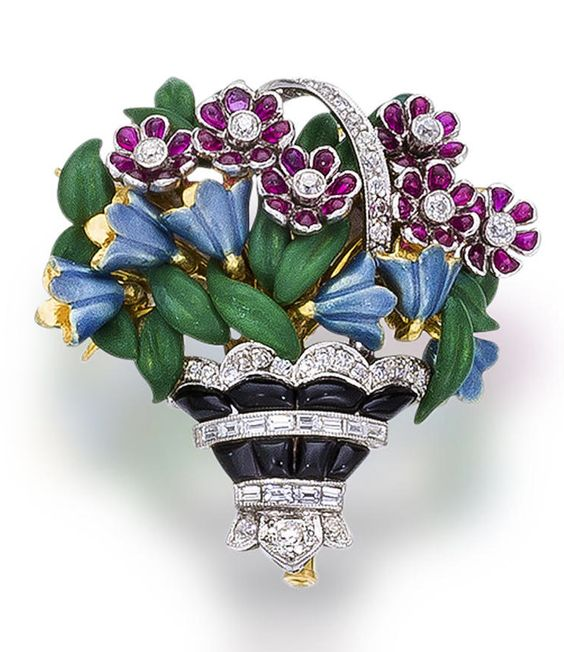 An enamel, diamond and gem-set brooch designed as a basket of polychrome enamel flowers, highlighted by calibré-cut, buff-top onyx and rubies, accentuated throughout by old European, old mine, and baguette-cut diamonds; mounted in platinum and eighteen karat gold.
