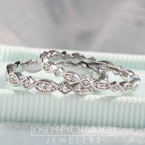 A marquise and diamond shape wedding band with diamonds.