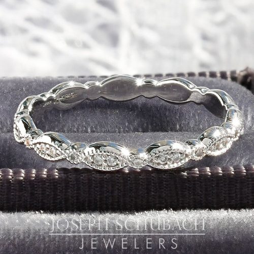 A marquise shape wedding band with round diamonds.
