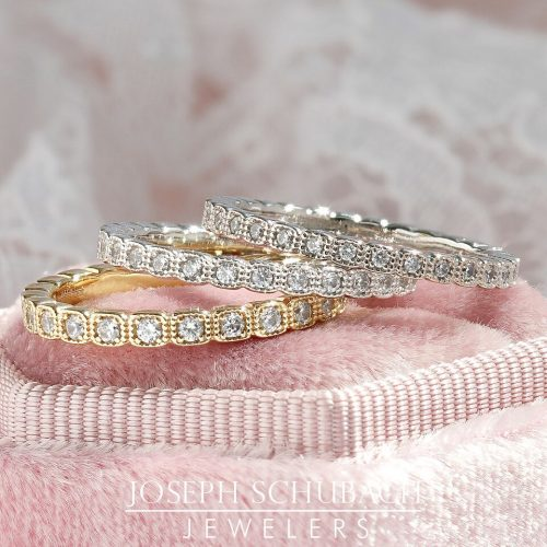 A square shape milgrain wedding band with round diamonds.
