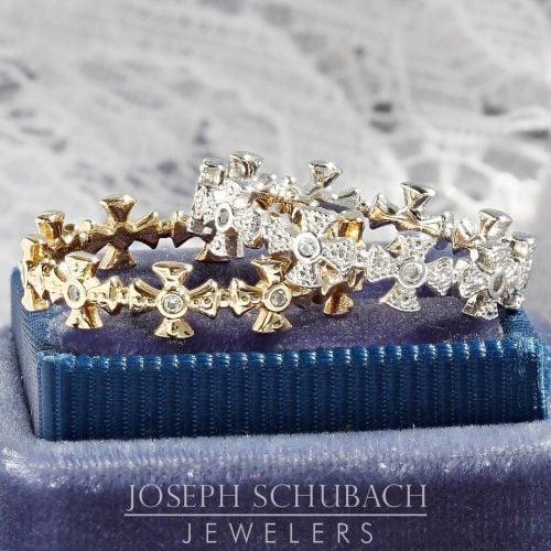 A beaded Maltese cross wedding ring with diamonds.