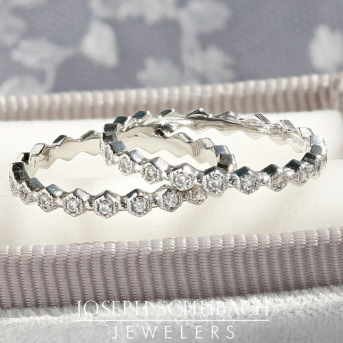 A hexagonal wedding band with round diamonds.