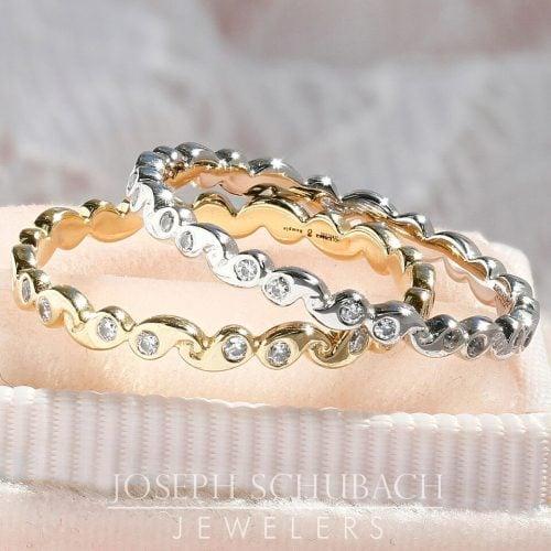 A smooth paisley design wedding band with diamonds.