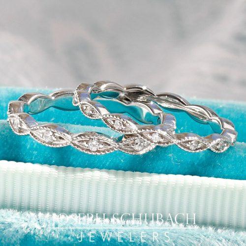 A marquise shape wedding band with single diamond.