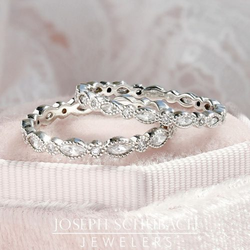 A bezel set marquise and round diamond wedding band.