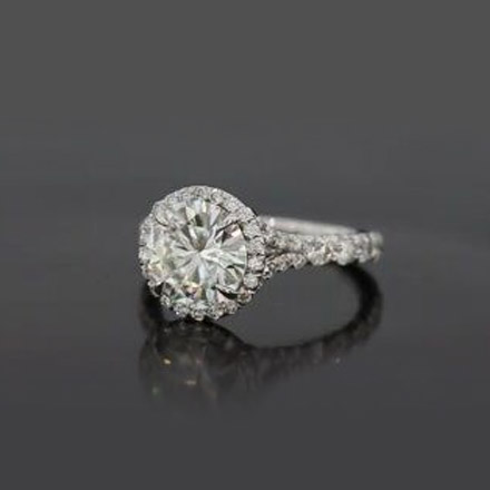 Split Shank Halo Engagement Ring A gorgeous split shank halo engagement ring, featuring a round brilliant stone halo'd with delicate pave. The split shank pave increases in size as the diamonds form a single shank.