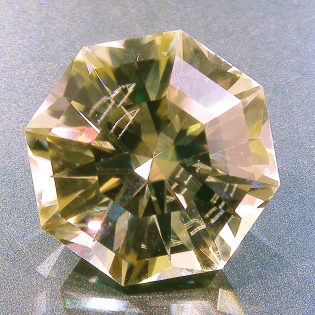 A faceted spodumene, with reflecting internal inclusion.